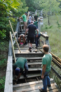 volunteers working on Hoffmaster State Park boardwalk