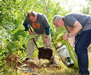 Gov. Snyder and DNR Director Creagh planting tree
