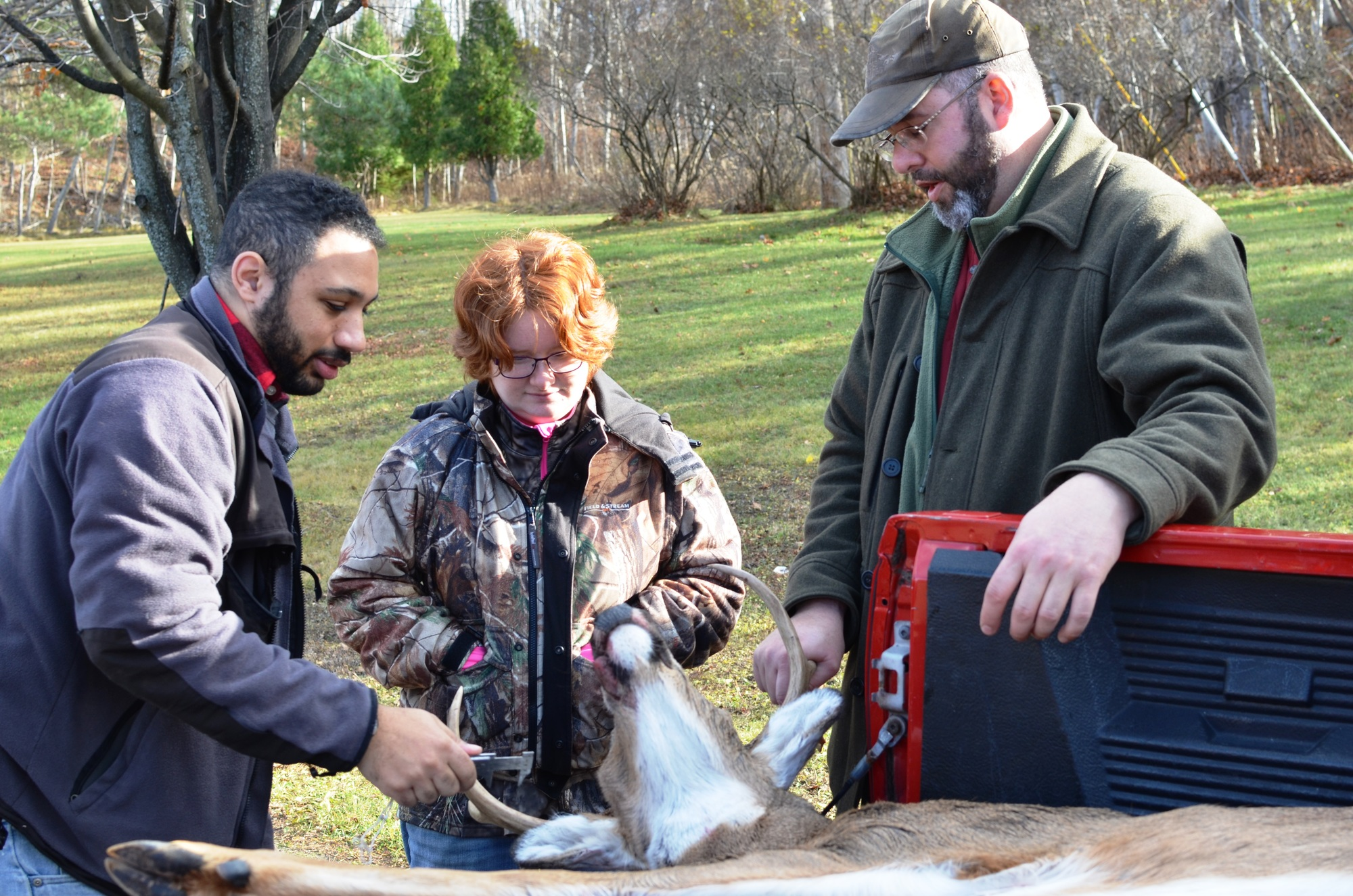 Northern Michigan University students check in a deer in Marquette