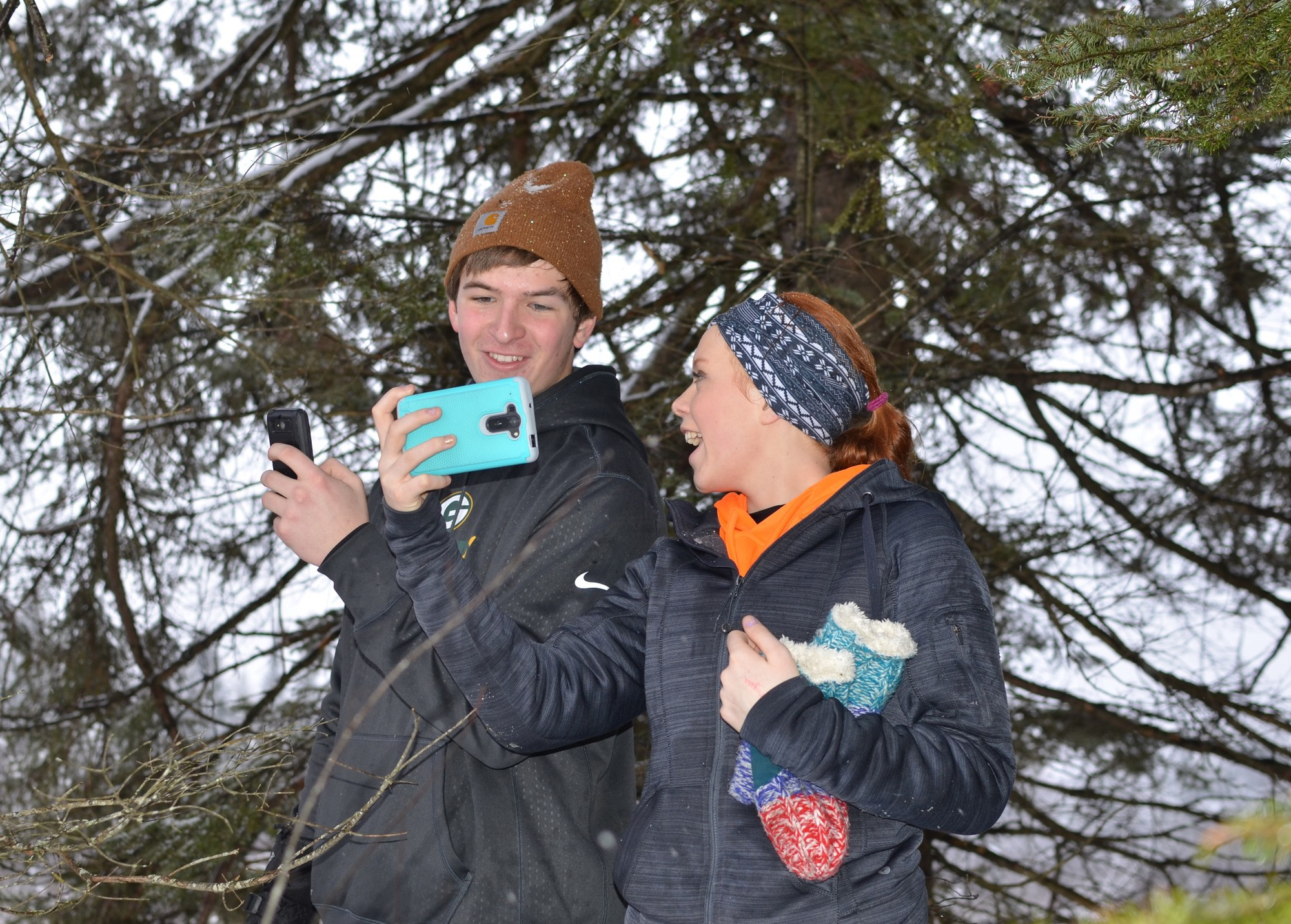 North Dickinson County Schools sophomores Jared Miller, 16, of Sagola and Juliann Wickman, 15, of Felch look at photos on their cellphones.