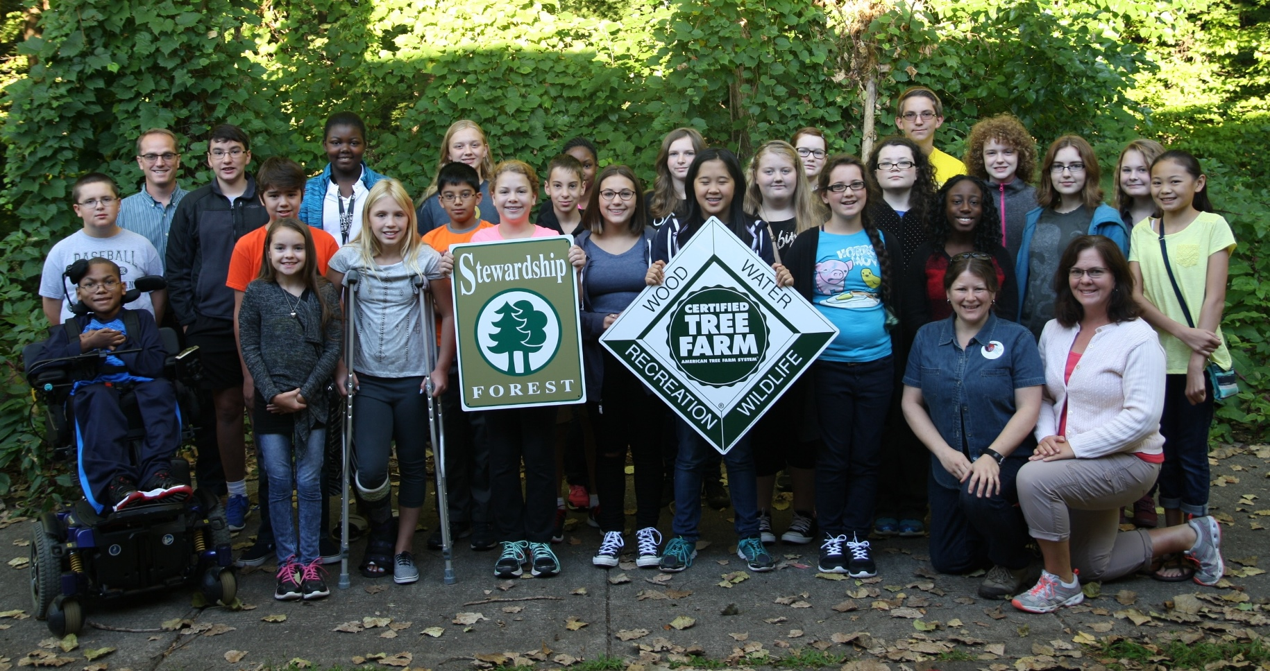 The Environmental Club at Frost Middle School in Livonia poses for a picture during a school forest outing in September 2015.