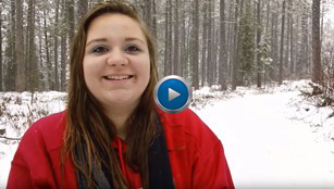still frame of a North Dickinson County Schools student, in a winter forest