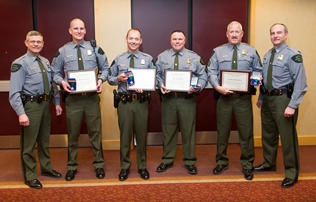 Four Michigan DNR conservation officers receiving Lifesaving Awards