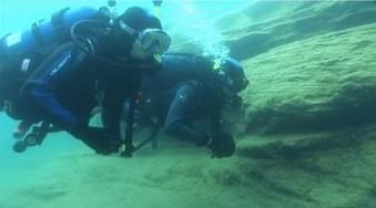 Two divers exploring underwater