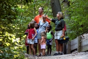 DNR staffer leading group of kids and adults on nature hike