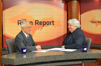 "J.R. Richardson, right, shares a laugh with Don Ryan, host of ""The Ryan Report."""