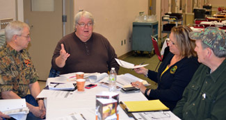 J.R. Richardson, center, is shown in discussions with the Upper Peninsula Chronic Wasting Disease Task Force.