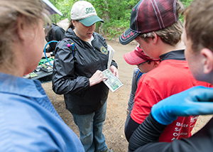 DNR staffer shows stewardship volunteers a map
