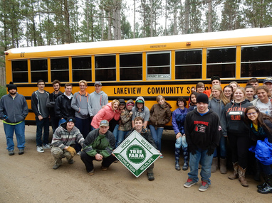 Students from Lakeview Community Schools pose for a photo after visiting their school forest.