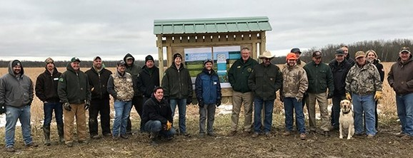 DNR staff and partners gather around the newly installed Adopt-a-Game-Area kiosk at Maple River State Game Area