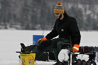 An angler enjoys a winter morning on an Upper Peninsula lake.