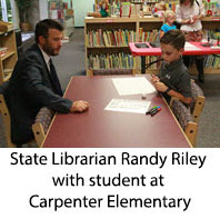 State librarian Randy Riley with student at Carpenter Elementary