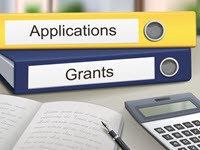 Binders labeled applications and grants