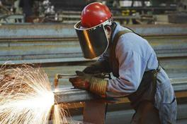 Guy welding in a factory
