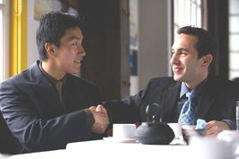 Two men shaking hands at tea