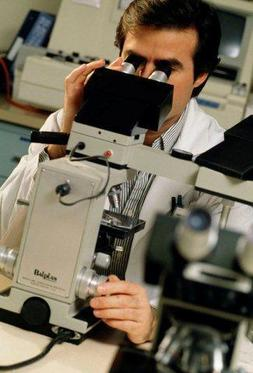 Man looking in microscope