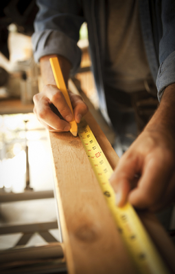 Man measuring board