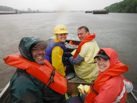 Happy, rain soaked volunteers on the way to the cleanup sites.