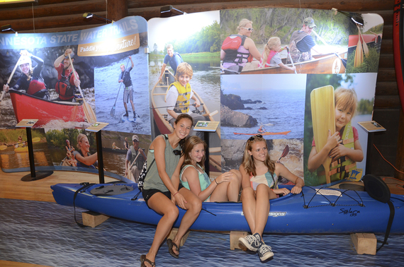 Three young women in the kayak that was part of the new State Water Trails display at the Minnesota State Fair.