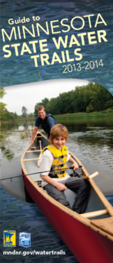 Front cover of the new Water Trails guide with image of a man and his young son in a canoe on the river.