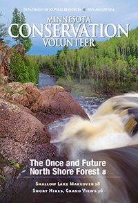 Cover of July-August 2014 issue of Minnesota Conservation Volunteer magazine showing high falls at Tettegouche State Park.