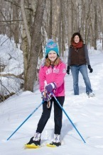 daughter and mother snowshoeing