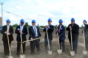 Governor Dayton and business leaders broke ground on the site of two new business expansions in Brooklyn Park