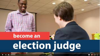 Election judge helps a voter to register