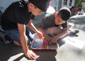 Two boys engage in summer learning activities