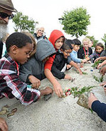 Children learning about erosion