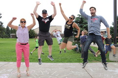 teachers and students jumping for joy