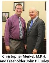 Freeholder John P. Curley and Christopher Merkel, M.P.H