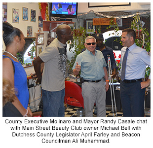 County Executive Molinaro and Mayor Randy Casale chat with Main Street Beauty Club owner Michael Bell with Dutchess County Legislator April Farley and