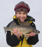 Child holding a walleye caught through the ice