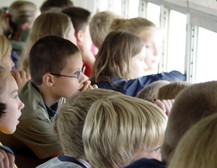 kids on school bus tour