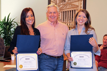 Commissioner Thompson presents certificates to Ashley Wilson and Brooke Tripp