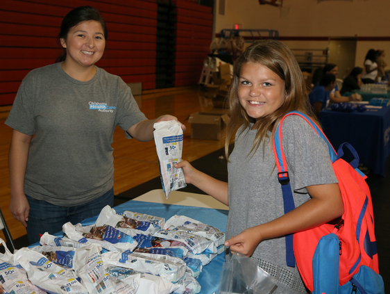 Student receives dental supplies at Riverside event