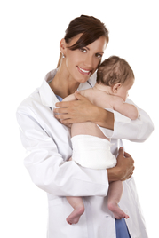 Female doctor cradles baby