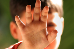 Closeup of  young child's hand in defensive position