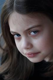 Closeup of young girl with sad face