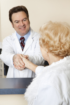 Doctor welcomes patient at reception desk