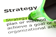 The word Strategy highlighted in green with felt tip marker