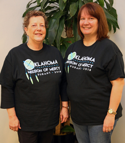 Tracy Matthews and Sara Gillum proudly wear their 2018 OkMOM T-shirts, which they received for volunteering