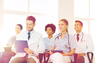 Five happy health care providers sit in a training