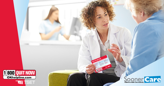 Female health care provider talks about the Tobacco Helpline with patient in waiting room