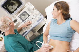 Doctor giving pregnant patient an ultrasound