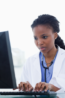Portrait of a female doctor using a computer