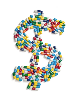 The dollar symbol made out of colorful pills isolated on white background.