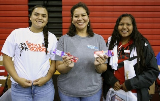 Dana Miller, OHCA Tribal Government Relations Director, with two Riverside students on Aug. 24, 2018.
