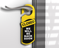 Door hanger with the message come in we are open hanged on a door handle.